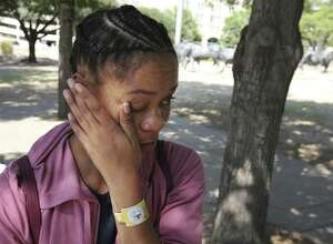 Harvey evacuee Paige Cane wipes way tears during a visit to Pioneer Plaza in downtown Dallas in September. Cane evacuated with her family from Port Arthur during flooding. A neighbor was the first to tell Cane that her landlord had posted an eviction notice on the door of her flooded apartment.