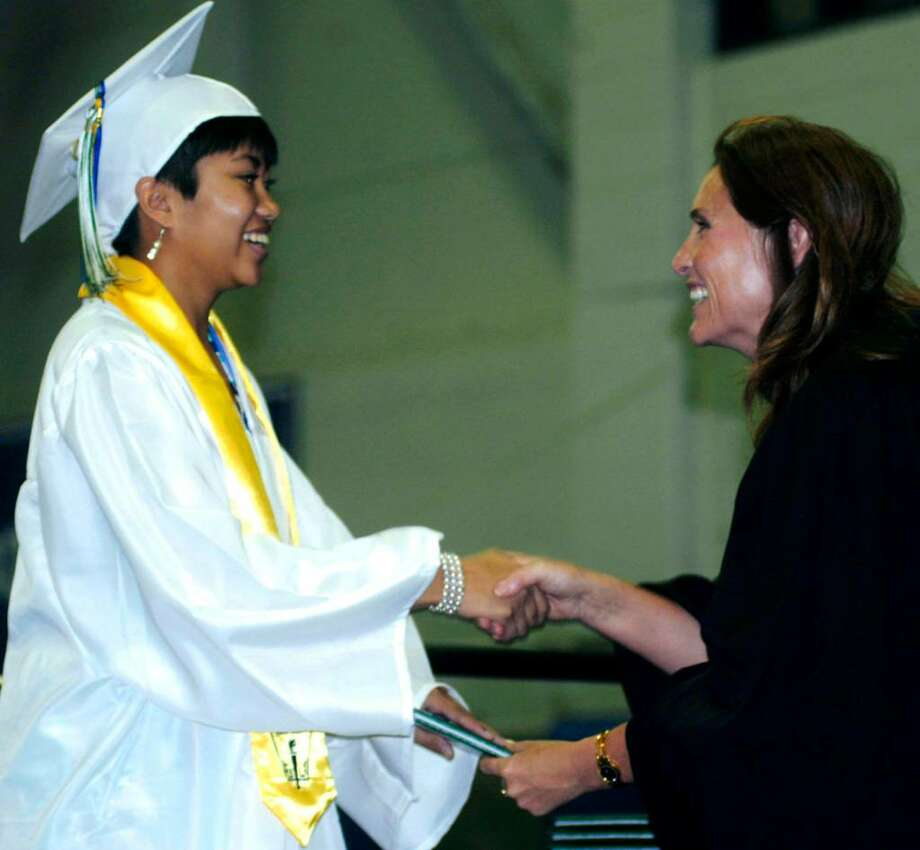 SPECTRUM/Elizabeth Marandola receives her diploma from Board of Education chairman Wendy Faulenbach at the June 19, 2010 New Milford High School commencement exercises at the O'Neil Center at Western Connecticut State University in Danbury. Photo: Norm Cummings / The News-Times