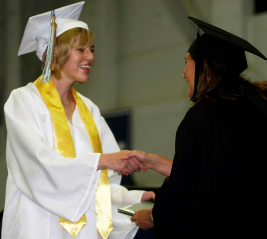 2010 New Milford High School commencement exercises at the O'Neil Center at Western Connecticut State University in Danbury. Photo: Norm Cummings / The News-Times