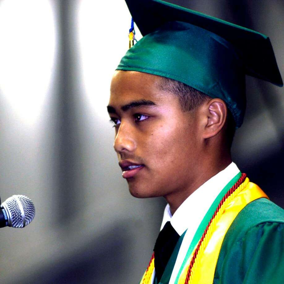 SPECTRUM/Valedictorian Eric Ho speaks at the June 19, 2010 New Milford High School commencement exercises at the O'Neil Center at Western Connecticut State University in Danbury. Photo: Norm Cummings / The News-Times