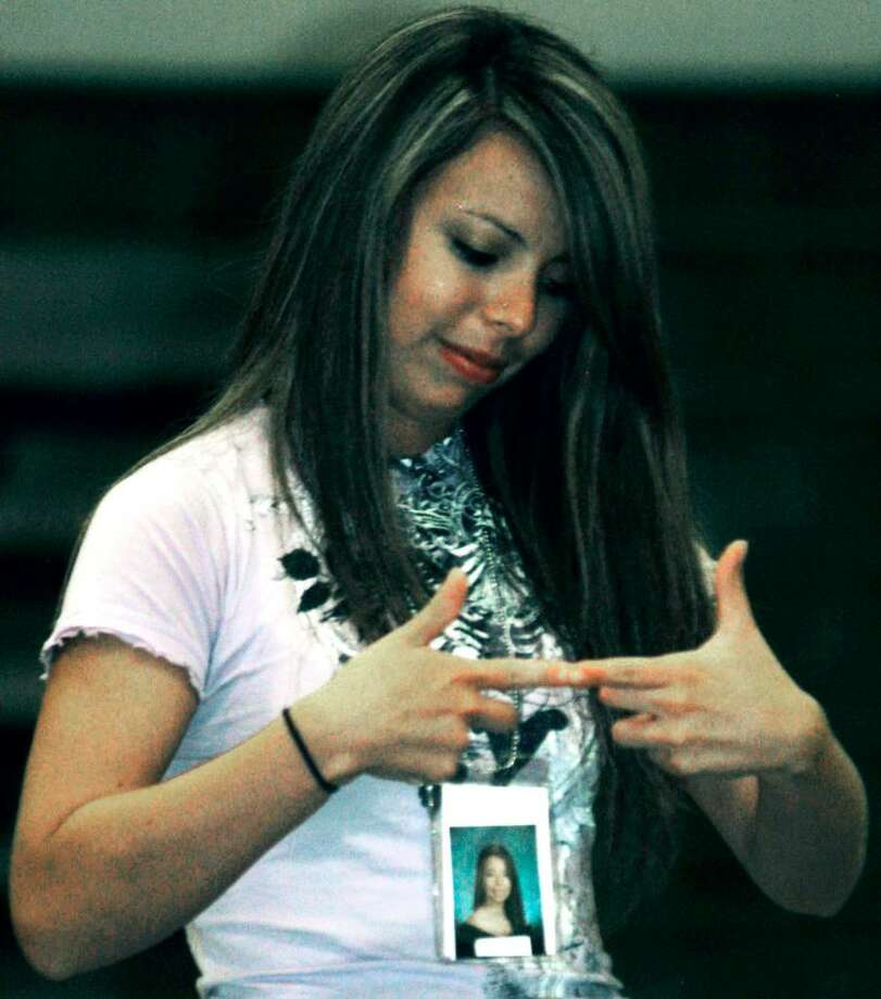 SPECTRUM/Ximena Salcedo is unable to separate her fingers during Dan LaRosa's suggestive thinking performance at the June 19, 2010 New Milford High School grad party. Photo: Norm Cummings / The News-Times