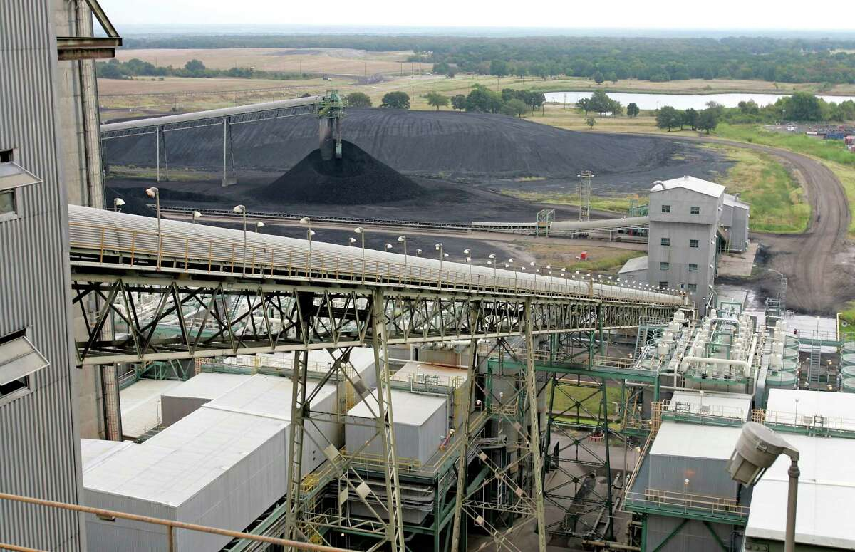 Coal moves up a conveyor belt into the Big Brown coal-fired power plant near Fairfield.