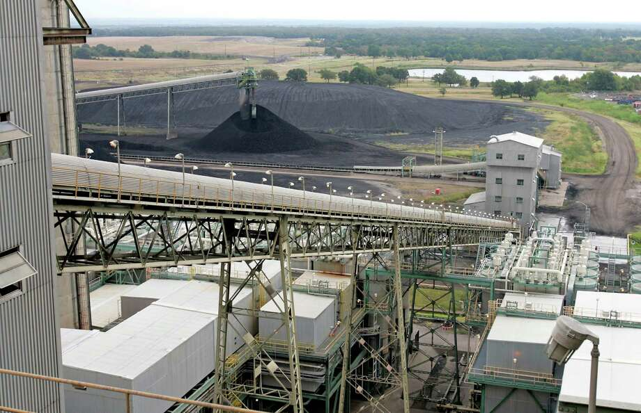Coal moves up a conveyor belt. Photo: David J. Phillip, STF / AP