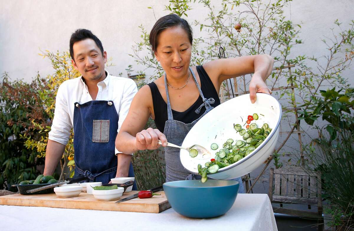 Chefs Steve Joo and Julya Shin, are the owners of a Korean ssam pop-up called Nokni, as seen on Mon. Sept.. 25, 2017, in Oakland, Ca. The chefs prepare dishes for a ssam party.