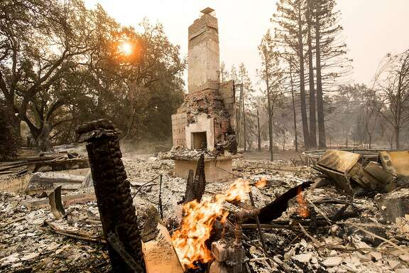 A chimney stands at a residence leveled by fire in Glen Ellen, Calif., on Monday, Oct. 9, 2017.