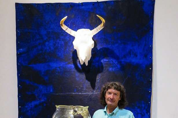 "Glass artist Clifford Rainey lost his his home, his studio and most of his work in the Atlas fire in Napa. He was photographed recently�at the Richmond Art Center, where his work ""White Bison #3"" (1990) is currently on view."