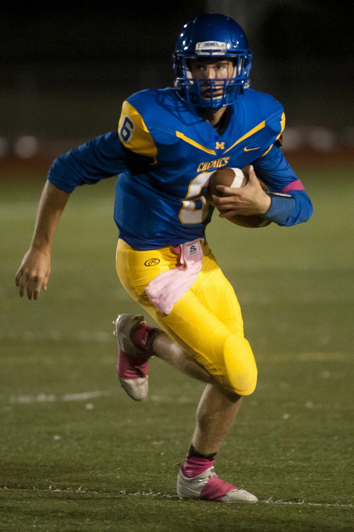 Midland senior Cad Methner carries the ball down the field during their game against Lapeer on Friday, Oct. 13, 2017 at Midland Community Stadium. (Katy Kildee/kkildee@mdn.net)