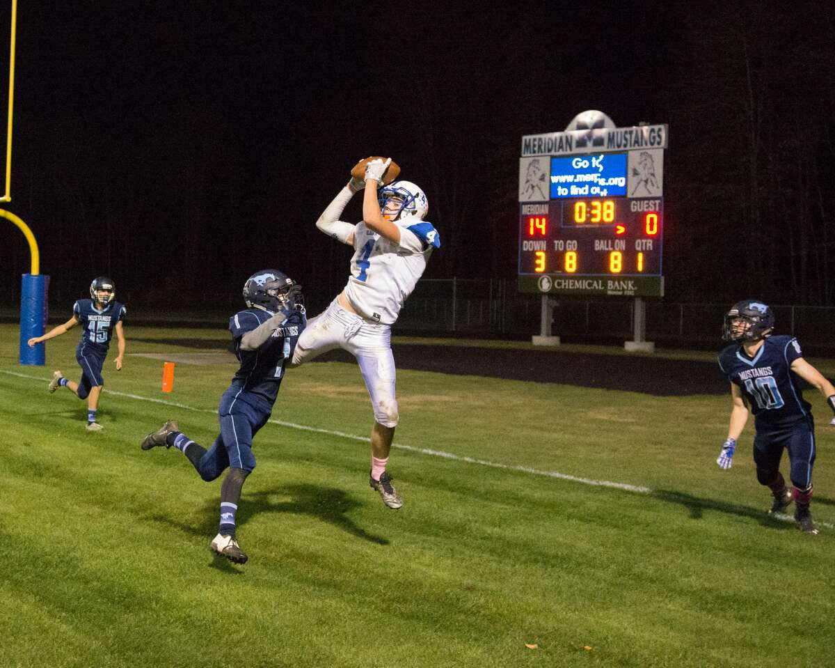 Kevin McKeever of Gladwin scoring a touchdown against Meridian at Meridian High School Friday, Oct. 13, 2017. (Steven Simpkins/for the Daily News)