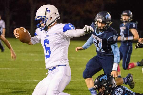 Austin Pahl running the ball after faking a hand off to Justin Greer of Gladwin at Meridian High School Friday, Oct. 13, 2017. (Steven Simpkins/for the Daily News)