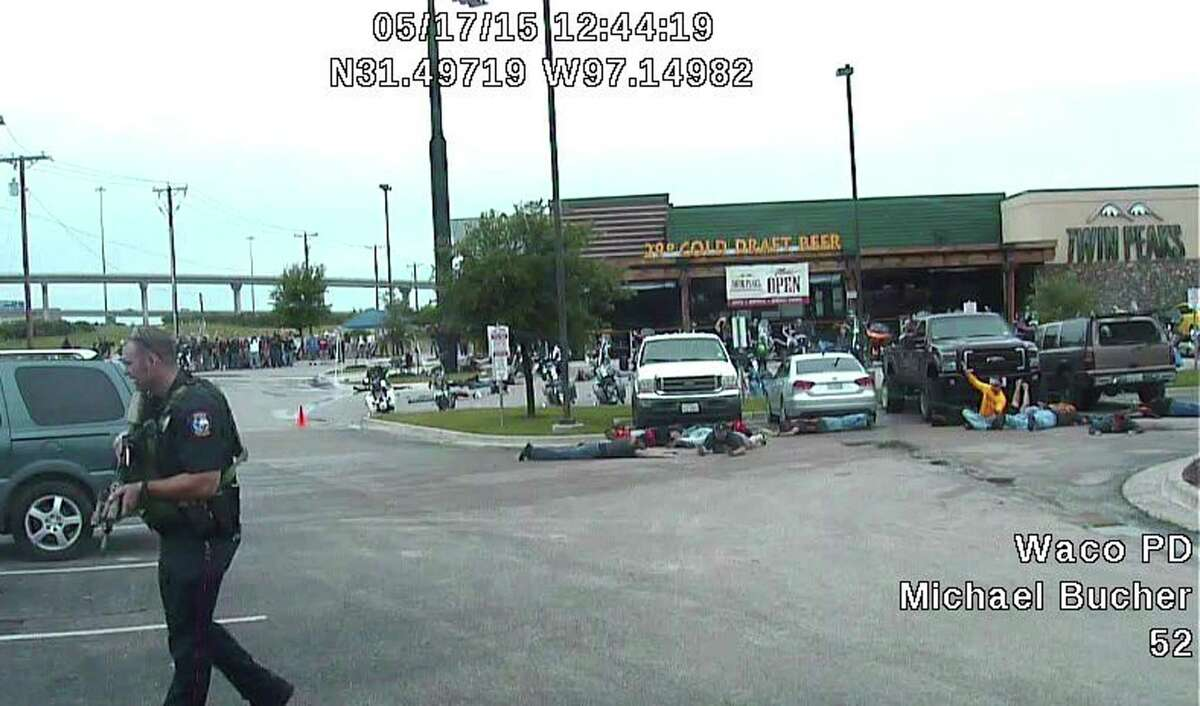 HOLD FOR STORY BY EMILY SCHMALL, This image from a May 17, 2015 police Dash-cam video shows the the scene in a parking lot of Twin Peaks restaurant after a shooting between two rival biker gangs in Waco, Texas. Law enforcement did nothing on the day to stop a meeting in Waco, Texas in 2015 that erupted into the deadliest shootout between biker gangs in U.S. history, even though they had detailed advance intelligence that the encounter between the Cossacks and Bandidos was likely to turn violent, according to a review by The Associated Press of a trove of evidence compiled by prosecutors for use in state trials of 154 bikers. (Waco Police Department via AP)