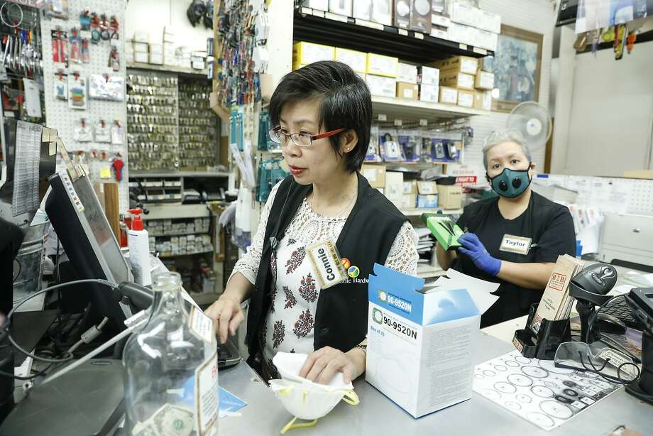 Cole Hardware assistant manager Connie Zhang, left, sells masks to a customer on Friday, Oct. 13, 2017 in San Francisco, Calif. Photo: Russell Yip, The Chronicle