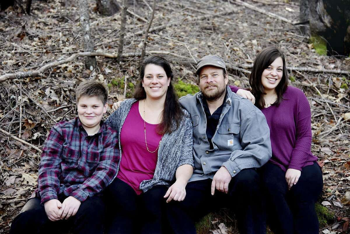 In this undated photo provided by Irma Muniz shows the Shepherd family, Jon and Sara Shepherd and their children, Kressa, and Kai. Kai, left, was killed after a wildfire tore through his family's home in Redwood Valley, Calif. on Monday, Oct. 9, 2017. He was 14 when he died, said his aunt, Mindi Ramos. Sara and 17-year-old daughter, Kressa, both sustained burns on 60% of their bodies. Jon sustained burns on 45% of his body. Relatives are trying to raise money to cover medical expenses and prepare to eventually bring the family to live with Sara's parents' home in Redwood Valley. (Irma Muniz via AP)