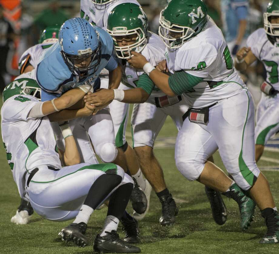 Monahans' Michael Smith holds on to Greenwood's Ryan Snodgrass till more defenders help bring him down 10/13/17 at J.M. King Stadium. Tim Fischer/Reporter-Telegram Photo: Tim Fischer/Midland Reporter-Telegram