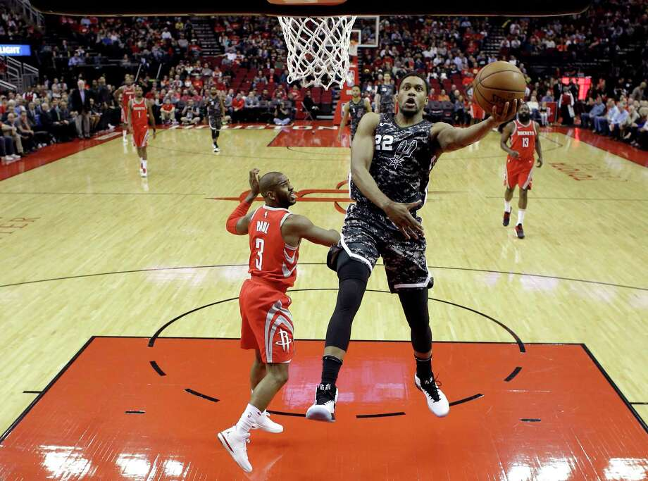San Antonio Spurs' Rudy Gay (22) goes up to shoot as Houston Rockets' Chris Paul (3) defends during the first half of an NBA basketball game Monday, March 12, 2018, in Houston. (AP Photo/David J. Phillip) Photo: David J. Phillip, Associated Press / Copyright 2018 The Associated Press. All rights reserved.