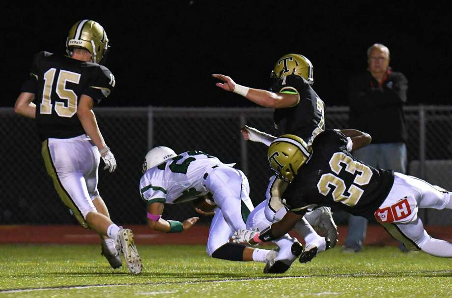 Norwalk quarterback Kyle Gordon dives into the end zone for a touchdown. Photo: Gregory Vasil / For Hearst Connecticut Media / Connecticut Post Freelance