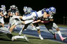 Darien's Brian Minicus attempts to dive into the endzone, just coming up short, during their game at Staples High School in Westport, Conn. on Friday, October 13, 2017.