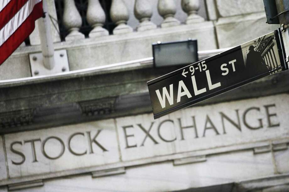 This July 16, 2013, file photo, shows a Wall Street street sign outside the New York Stock Exchange. U.S. stock indexes ticked higher in early trading on Tuesday, Oct. 3, 2017, and tacked on a bit more to their records set a day earlier. Trading was again very quiet, with only modest moves for bond yields, commodities and other markets. Stock markets were closed in Germany, China and South Korea for holidays. Photo: Mark Lennihan / Associated Press / Copyright 2016 The Associated Press. All rights reserved. This material may not be published, broadcast, rewritten or redistribu