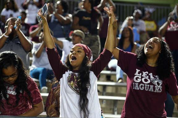 Central fans Hannah Celestain and Shaye Arceneaux cheer as the Jaguars play against Nederland at the Thomas Center on Friday night.  Photo taken Friday 10/13/17 Ryan Pelham/The Enterprise