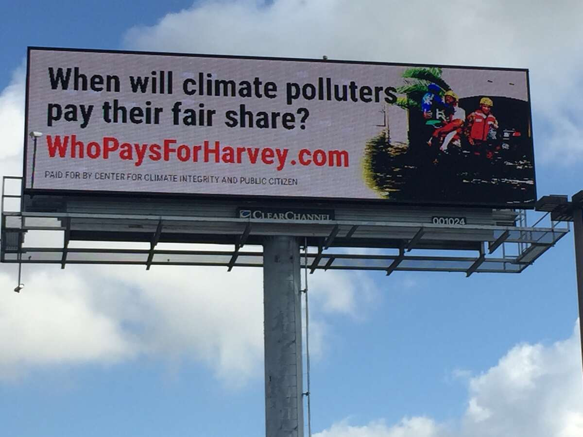 This billboard is part of a campaign by environmentalists who say energy companies are partially responsible for Hurricane Harvey's flooding.