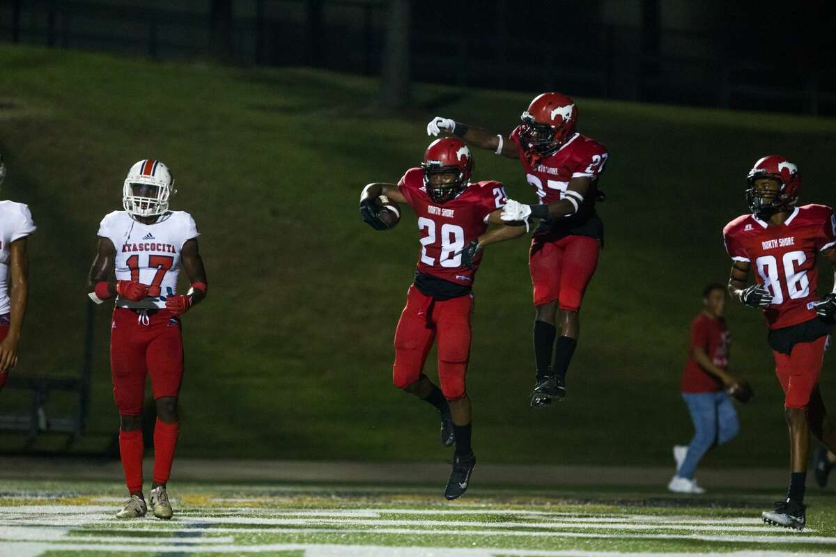 North Shore WR Zorhan Rideaux (28) and Darion McDaniel (27) celebrate after a touchdown during the second half of action between North Shore vs Atascocita high school football game at Galena Park ISD Stadium, Friday, Oct. 13, 2017, in Houston. Atascocita defeated North 38-21. ( Juan DeLeon/for the Houston Chronicle )