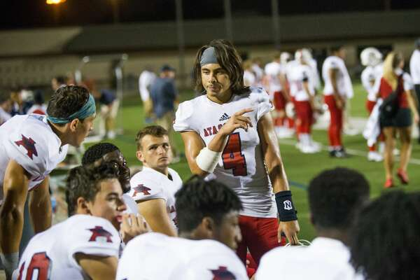Atascocita QB Jack Roe (4) talking to the offensive line during the second half of action between North Shore vs Atascocita high school football game at Galena Park ISD Stadium, Friday, Oct. 13, 2017, in Houston. Atascocita defeated North 38-21. ( Juan DeLeon/for the Houston Chronicle )