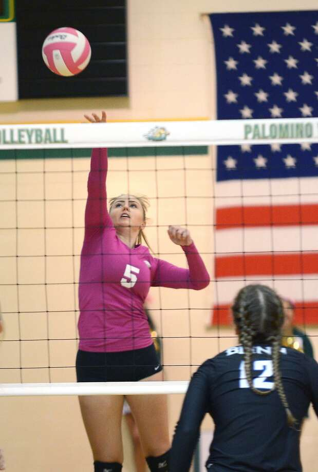 Outside hitter for the Lady Palominos Lucie Mahelova hits the ball away from a Blinn defender, Friday, October 13, 2017, at Maravillo Gym. Photo: Cuate Santos /Laredo Morning Times File / Laredo Morning Times