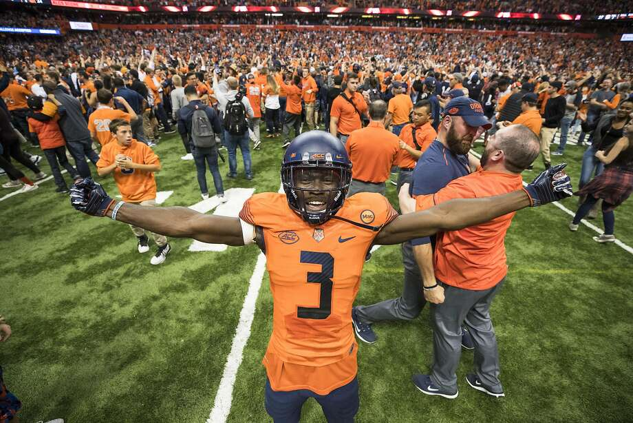 Ervin Philips of Syracuse celebrates the upset win over Clemson after fans stormed the field at the Carrier Dome in New York. Photo: Brett Carlsen, Getty Images
