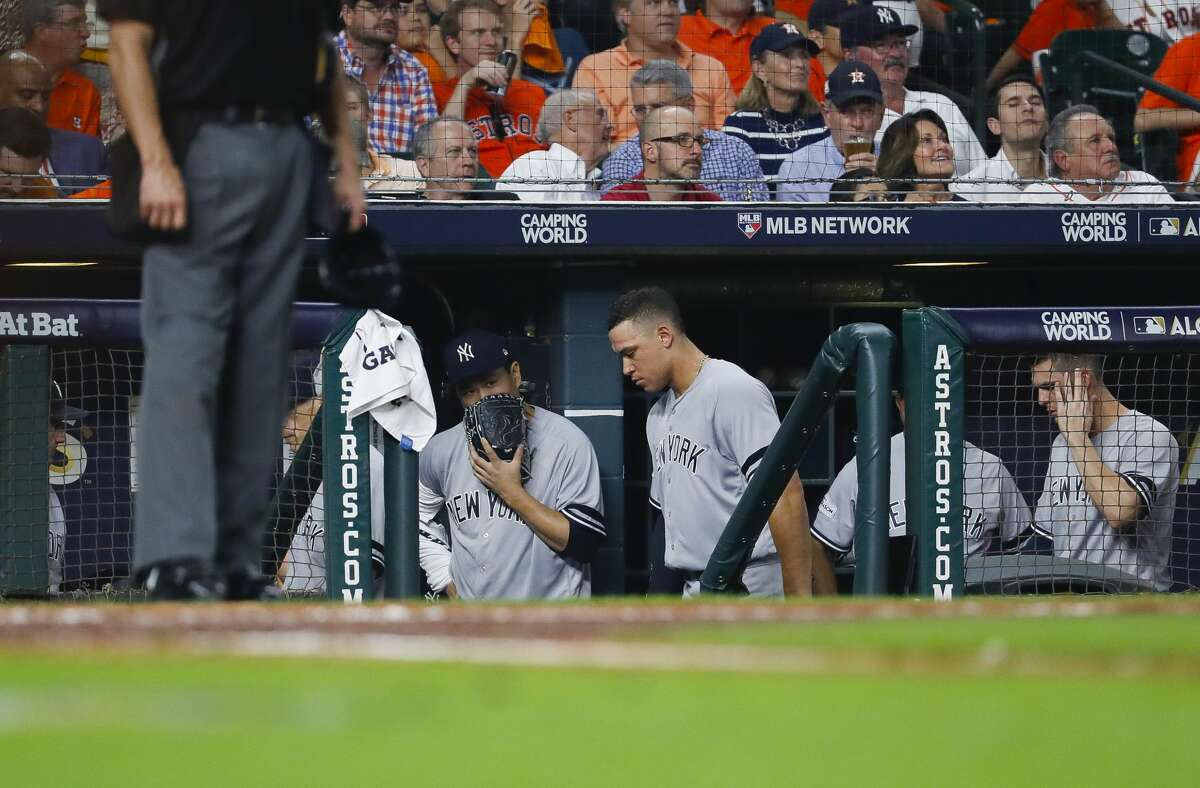 Yankees starting pitcher Masahiro Tanaka (left) and right fielder Aaron Judge (99) stand in the Minute Maid Park dugout during their Game 1 loss to the Astros in the 2017 ALCS.