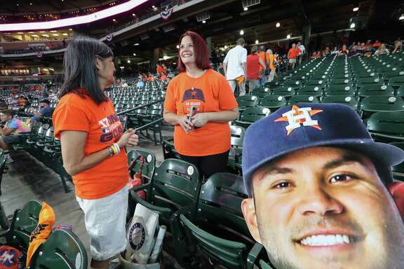 Long time Astros fans Barbara Moon (left) and Greis Perez talks to before the start of Astros Yankees ALCS Game 1 Friday, Oct. 13, 2017, in Houston. Perez said she couldn't afford her regular seats for the Playoffs, so she opted for another seat, but hoped she would be able to stand and watch.