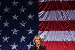 Secretary of Education Betsy DeVos speaks at the Washington Policy Center's annual gala at the Hyatt Regency Bellevue, Friday, Oct. 13, 2017, while hundreds protested outside.