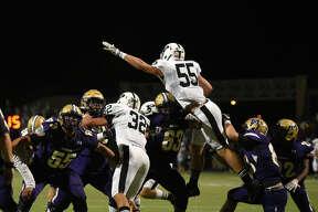 Permian Matt Jones attempts to block a kick from Midland High on Oct. 13, 2017, at Grande Communications Stadium.  James Durbin/Reporter-Telegram