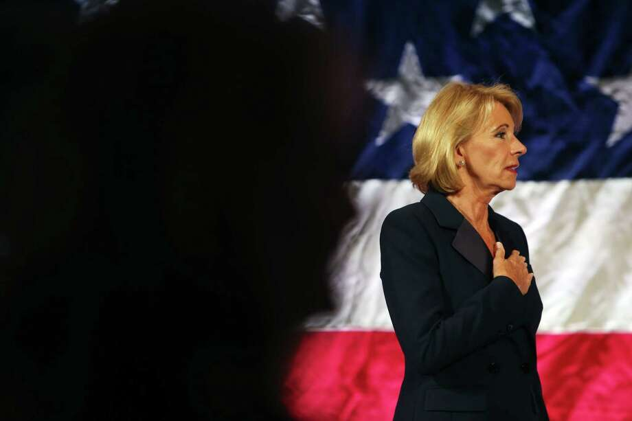 Secretary of Education Betsy DeVos stands for the National Anthem before speaking at the Washington Policy Center's annual gala, Friday, Oct. 13, 2017. Photo: GENNA MARTIN, SEATTLEPI / SEATTLEPI.COM