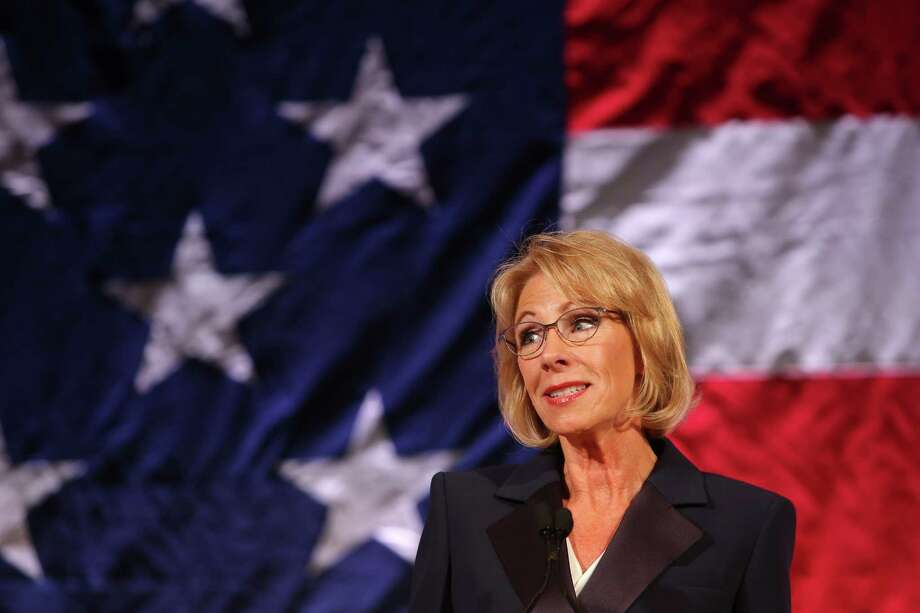 Secretary of Education Betsy DeVos speaks at the Washington Policy Center's annual gala at the Hyatt Regency Bellevue, Friday, Oct. 13, 2017, while hundreds protested outside. Photo: GENNA MARTIN, SEATTLEPI / SEATTLEPI.COM