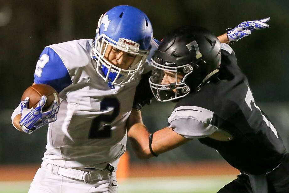 Jay's Danny Amezquita (left) tries to get past Clark's Camden Morgan during the second half of their District 28-6A Zone B high school football game at Gustafson Stadium on Friday, Oct. 13, 2017. Jay held on to beat Clark 47-46. MARVIN PFEIFFER/mpfeiffer@express-news.net Photo: Marvin Pfeiffer /San Antonio Express-News / Express-News 2017