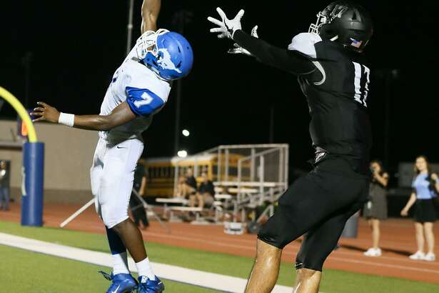 Jay's Malik Ross (left) rises to deflect a pass intended for Clark's Luke Gibson on a two-point conversion attempt with 13 seconds remaining in the game. Jay held on to beat Clark 47-46. A reader praises the photographer, Marvin Pfeiffer, for capturing the moment so dramatically.