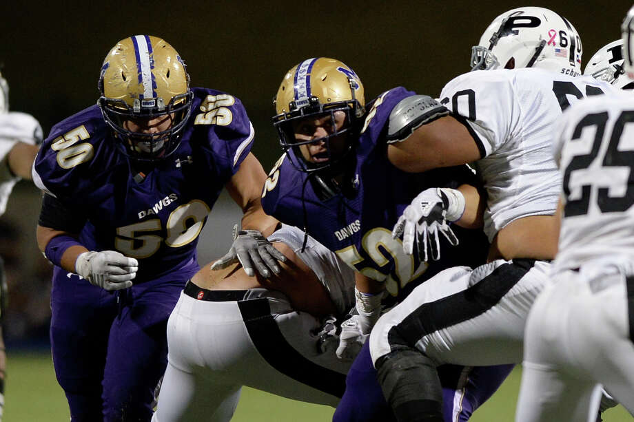 Midland High's Isaiah Hernandez (50) and Ethan Ruiz (52) try to get past the Permian offensive line on Oct. 13, 2017, at Grande Communications Stadium.  James Durbin/Reporter-Telegram Photo: James Durbin