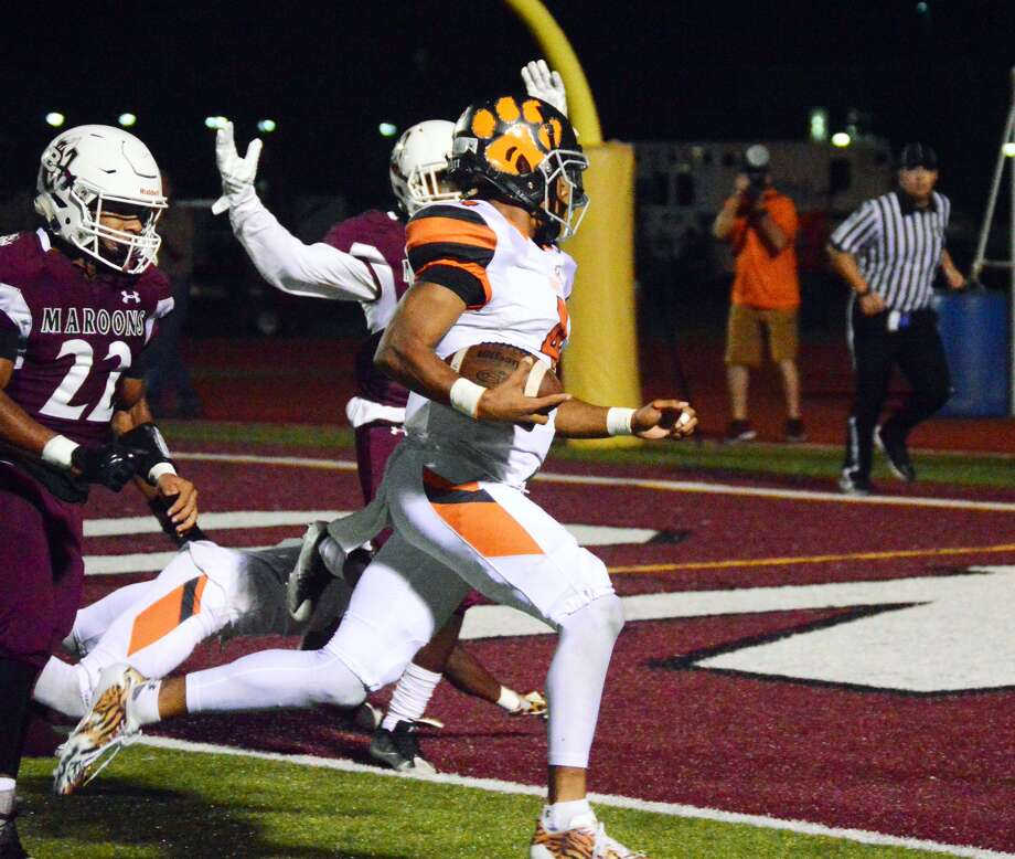 Edwardsville quarterback Kendall Abdur-Rahman, front, rushes into the end zone for one of his five rushing touchdowns against Belleville West on Friday in Belleville.