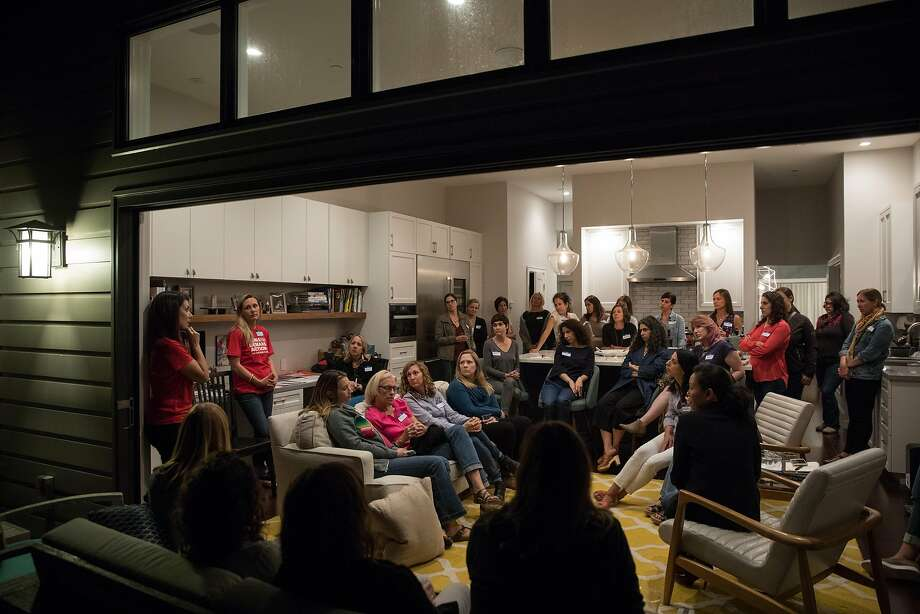 Catherine Stefani (red shirt at left), leads an inform ational meeting in a Glen Park home about the gun control group Moms Demand Action for Gun Sense in America. Photo: Erin Lubin, Special To The Chronicle