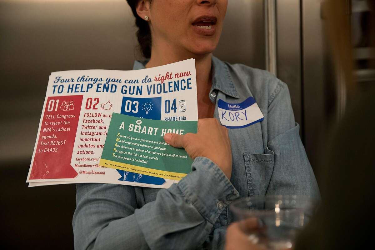 on Sunday, Oct. 8, 2017 in San Francisco, CA San Francisco resident, Kory Orlanski, holds handouts she picked up after hearing Catherine Stefani, the Moms Demand Action for Gun Sense local group leader and SF County Clerk, speak at an informational meeting about the gun advocacy group in the San Francisco home of Rhiana Maidenberg, on Sunday October 8, 2017.
