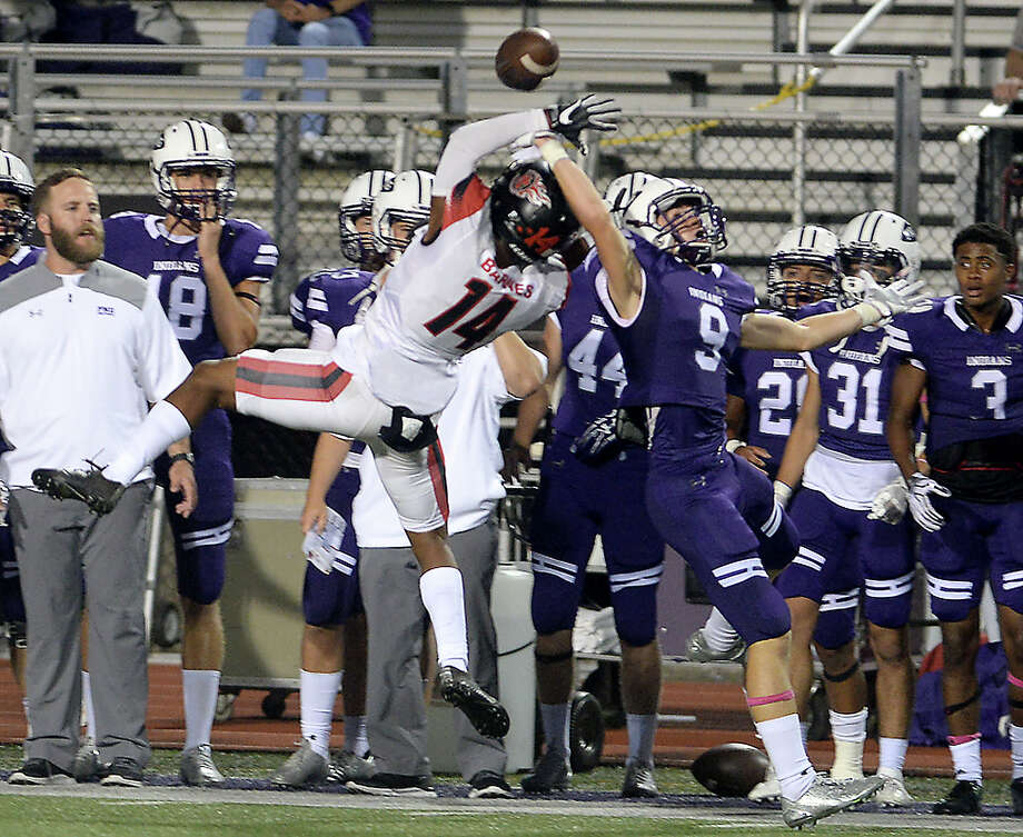 Port Neches - Groves' Kaleb Wuenschel tries to complete the pass as Port Arthur Memorial's Martavian Barnes tries for the interception during their match-up Friday night at PNG. Both teams entered the field undefeated. Photo taken Thursday, October 12, 2017 Kim Brent/The Enterprise Photo: Kim Brent / BEN