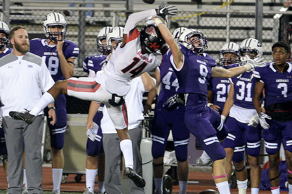 Port Neches - Groves' Kaleb Wuenschel tries to complete the pass as Port Arthur Memorial's Martavian Barnes tries for the interception during their match-up Friday night at PNG. Both teams entered the field undefeated. Photo taken Thursday, October 12, 2017 Kim Brent/The Enterprise