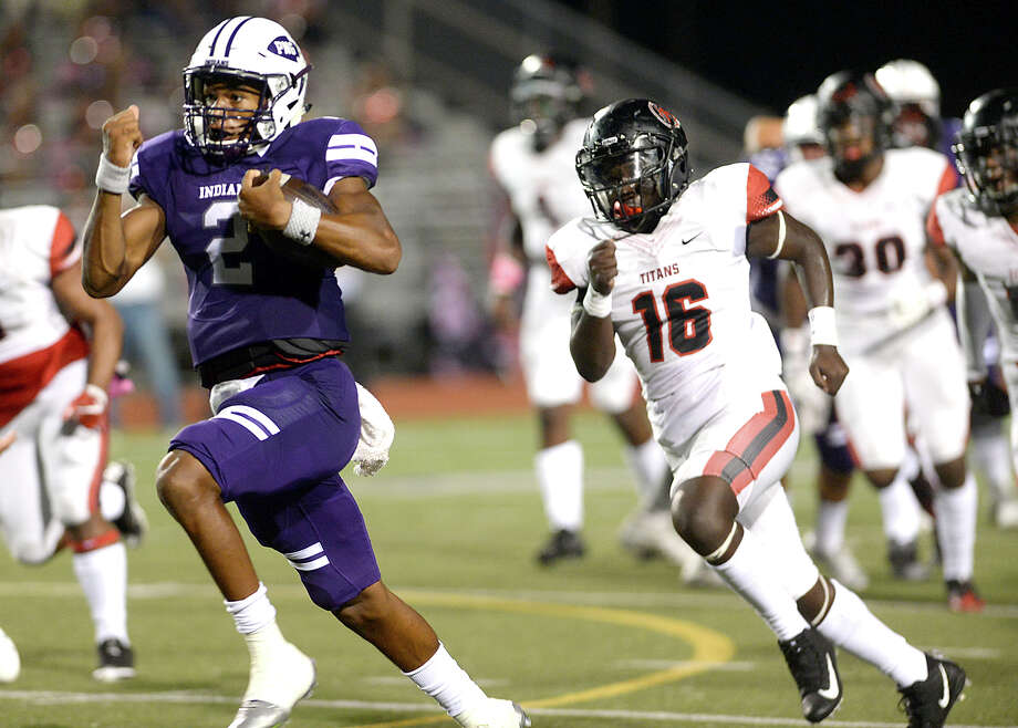 Port Neches - Groves' Roschon Johnson leaps past Port Arthur Memorial's defense as he carries the ball during their match-up Friday night at PNG. Both teams entered the field undefeated. Photo taken Thursday, October 12, 2017 Kim Brent/The Enterprise Photo: Kim Brent / BEN