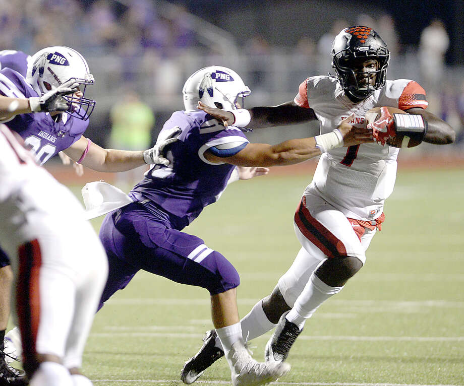 Port Neches - Groves' defense looks to stop Port Arthur Memorial's Keitha Jones during their match-up Friday night at PNG. Both teams entered the field undefeated. Photo taken Thursday, October 12, 2017 Kim Brent/The Enterprise Photo: Kim Brent / BEN