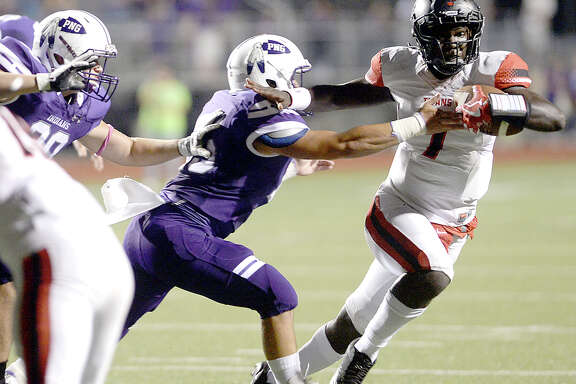 Port Neches - Groves' defense looks to stop Port Arthur Memorial's Keitha Jones during their match-up Friday night at PNG. Both teams entered the field undefeated. Photo taken Thursday, October 12, 2017 Kim Brent/The Enterprise
