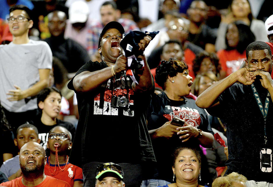 Port Arthur Memorial's fans cheer on the Titans during their match-up Friday night at PNG. Both teams entered the field undefeated. Photo taken Thursday, October 12, 2017 Kim Brent/The Enterprise Photo: Kim Brent / BEN