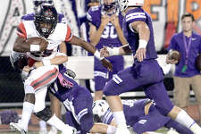 Port Neches - Groves' defense takes down Port Arthur Memorial's Elijah Hines during their match-up Friday night at PNG. Both teams entered the field undefeated. Photo taken Thursday, October 12, 2017 Kim Brent/The Enterprise