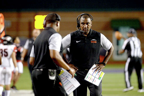 Port Arthur Memorial's coach Kenny Harrison talks with assistants as they face PNG during their match-up Friday night at PNG. Both teams entered the field undefeated. Photo taken Thursday, October 12, 2017 Kim Brent/The Enterprise