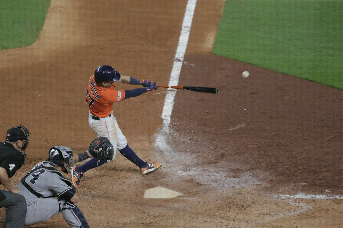Houston Astros second baseman Jose Altuve (27) connects for a single in the bottom of the sixth inning during game one of the American League Champsionship Series against the New York Yankees on Friday, Oct. 13, 2017, in Houston. Astros won the game 2-1. ( Elizabeth Conley / Houston Chronicle )