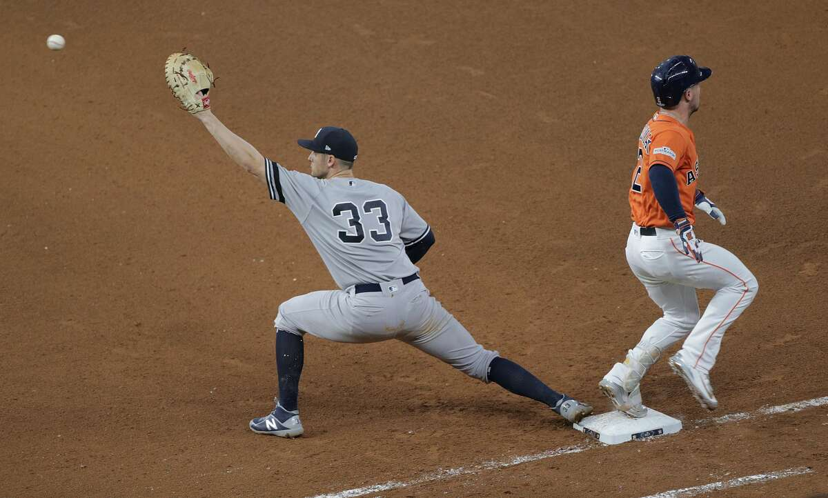 Houston Astros third baseman Alex Bregman (2) gets to first in plenty of time as New York Yankees first baseman Greg Bird (33) stretches out for the ball in the bottom of the seventh inning on Friday, Oct. 13, 2017, in Houston. ( Elizabeth Conley / Houston Chronicle )