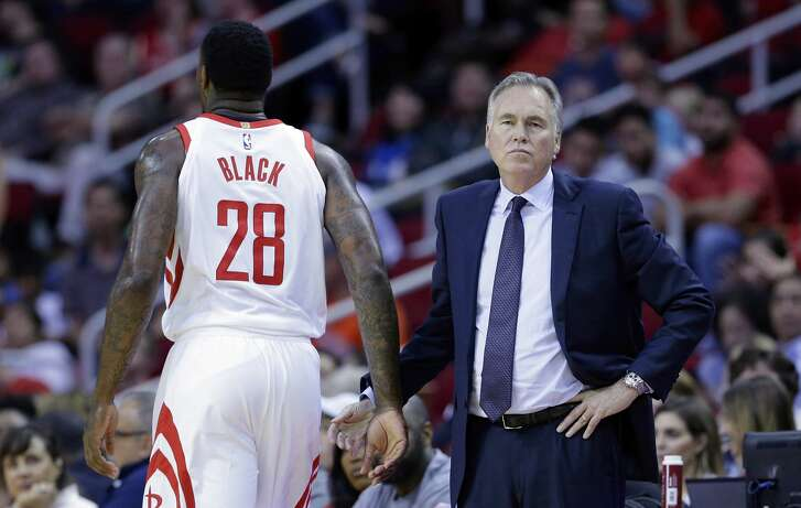 Houston Rockets forward Tarik Black (28) gets a low five from head coach Mike D'Antoni as he heads to the bench in the second half of an NBA preseason basketball game against the San Antonio Spurs Friday, Oct. 13, 2017, in Houston. (AP Photo/Michael Wyke)